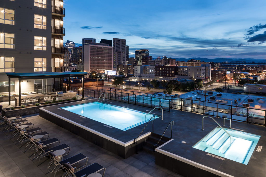 resort pool with denver skyline