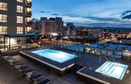 resort pool with denver skyline